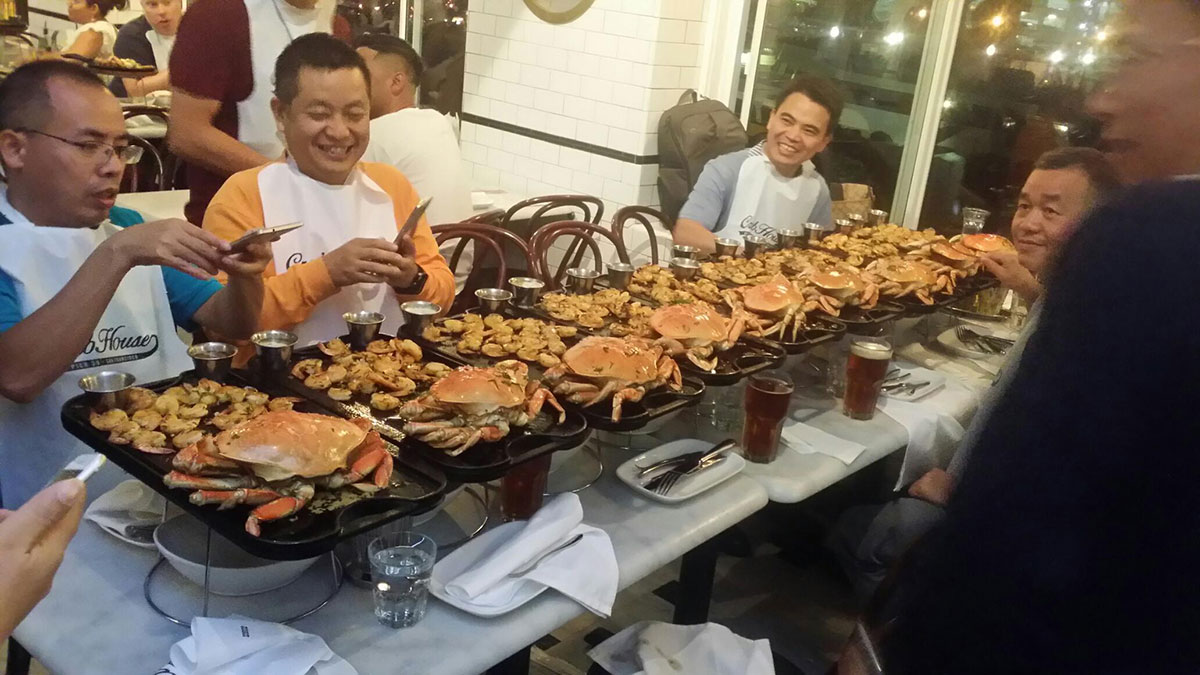 People feasting on Crab and Shrimp